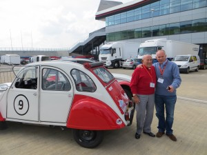 Sir Stirling Moss with veteran journalist Peter Windsor, after they had driven our 2CV round the Silverstone circuit at the Silverstone Classic Press Day on April 30 2014.